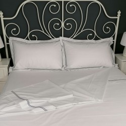 Flat sheet blue trim Egyptian Cotton 200 Thread Count Percale Porto laid out on bed